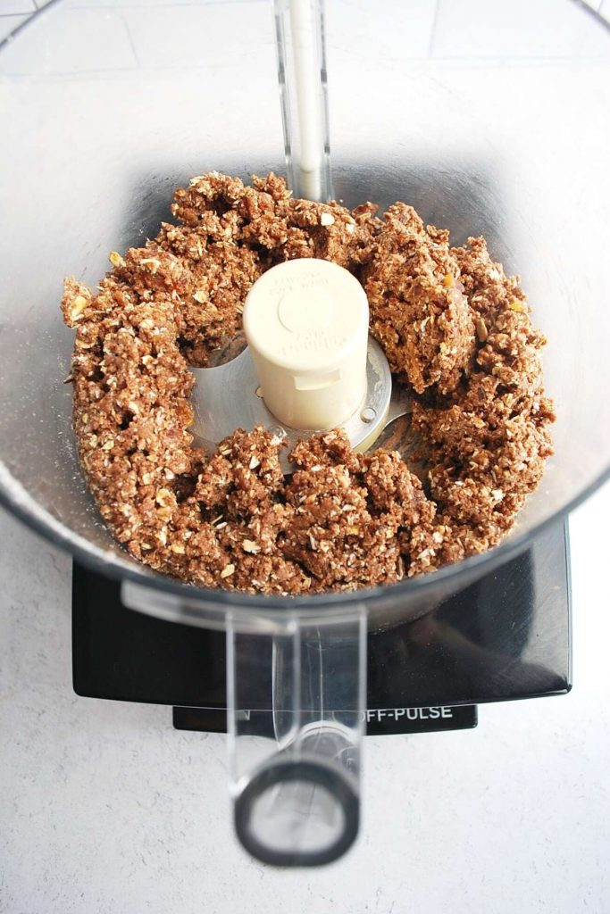 protein date ball mixture in a food processor mixed and crumbly