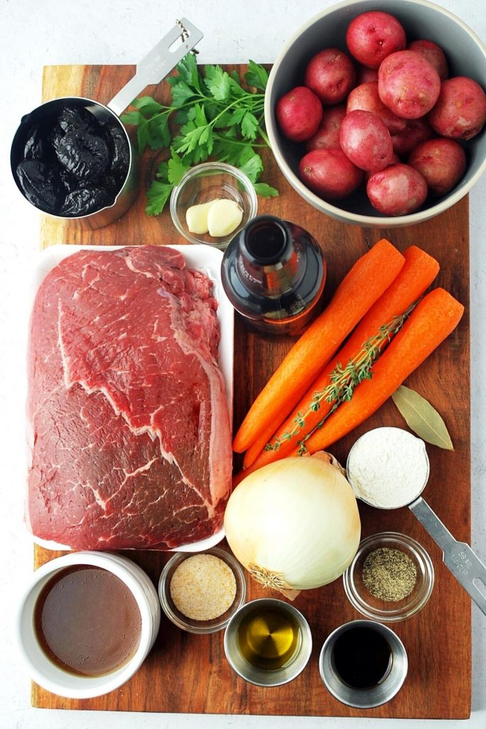ingredients for Irish pot roast on a wooden board