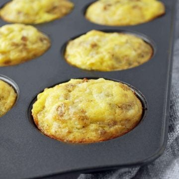 Sausage egg muffins in a muffin pan fresh from the oven