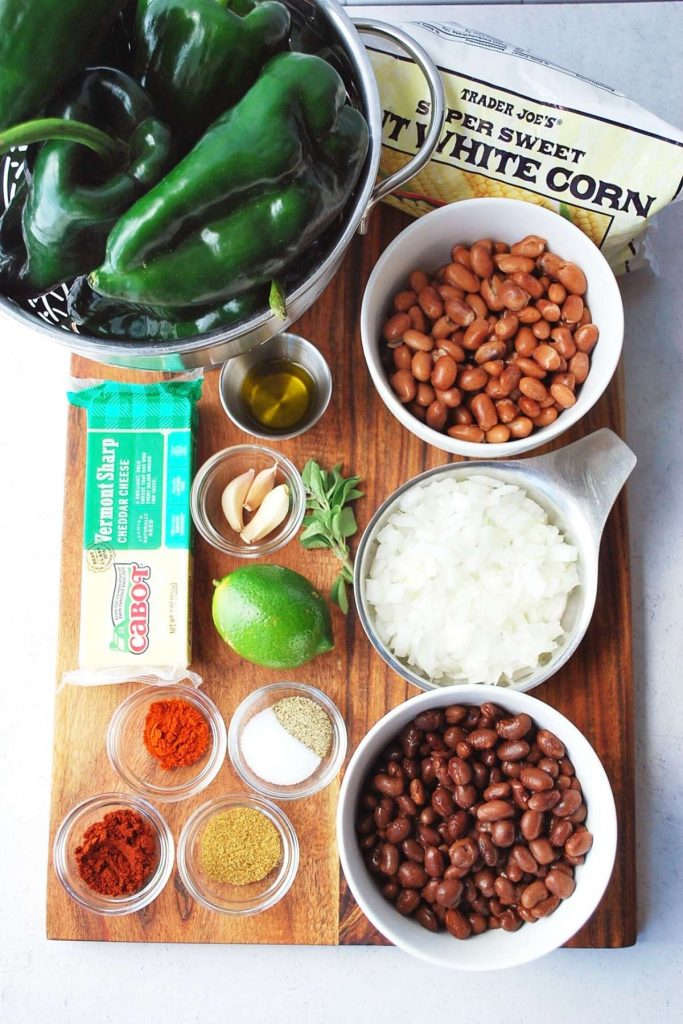 ingredients for stuffed poblano peppers on a cutting board