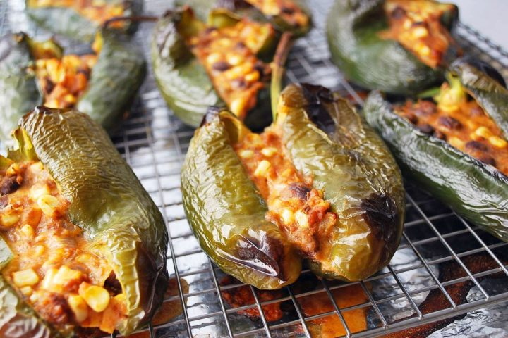 stuffed poblano peppers fresh from the oven on a baking sheet