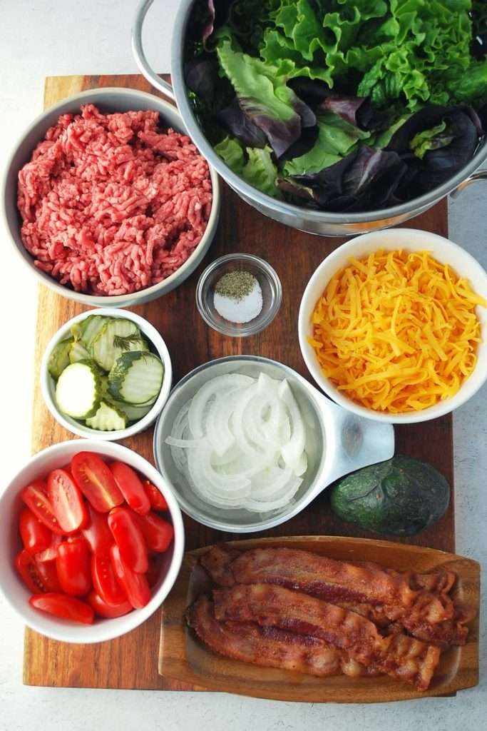 ingredients for burger bowls on a cutting board