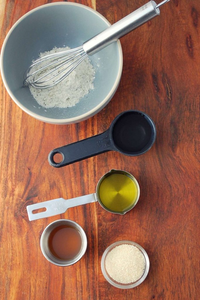 ingredients for ranch vinaigrette on a cutting board
