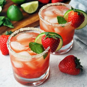 close up of two strawberry mojitos in low ball glasses