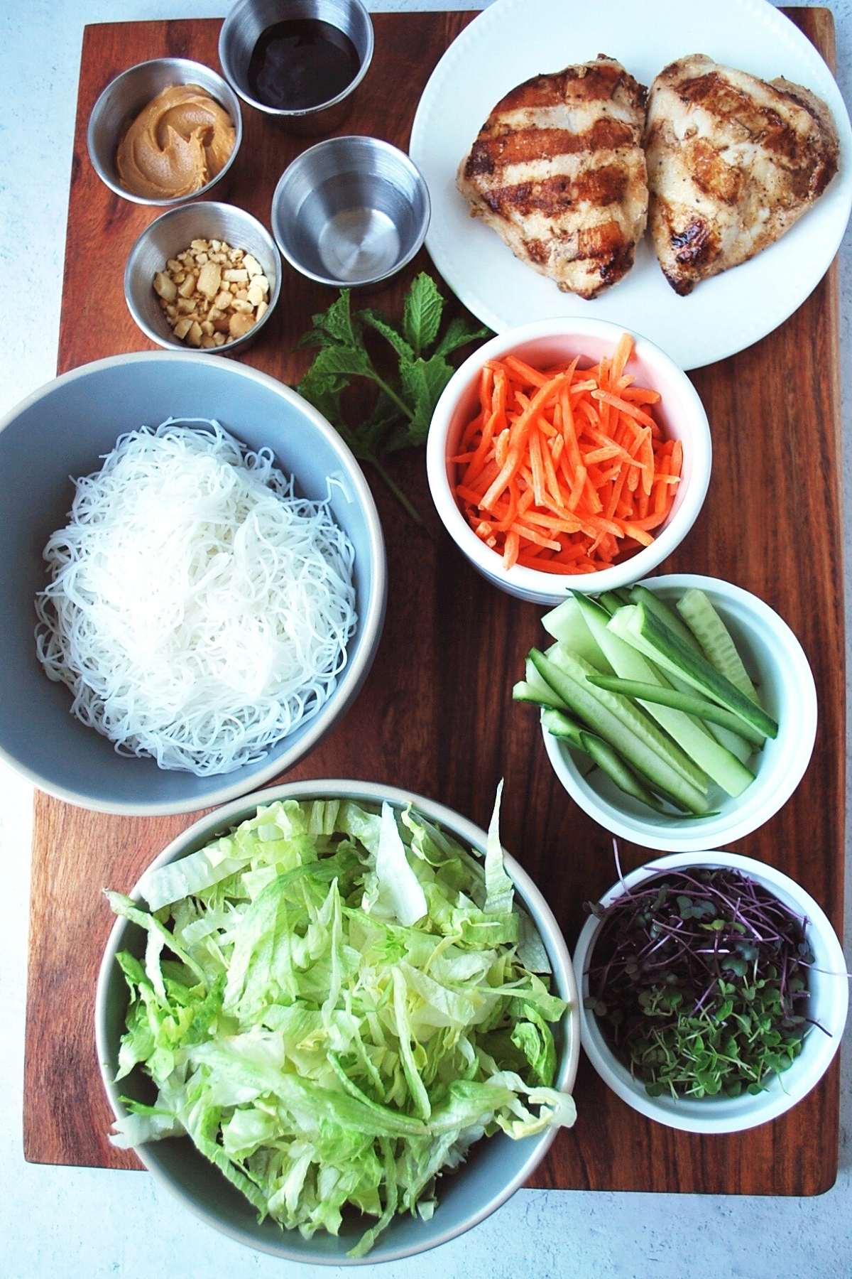 ingredients for spring roll bowls on a cutting board