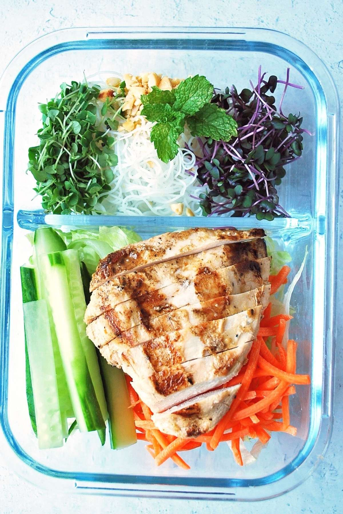chicken spring roll salad in a meal prep container