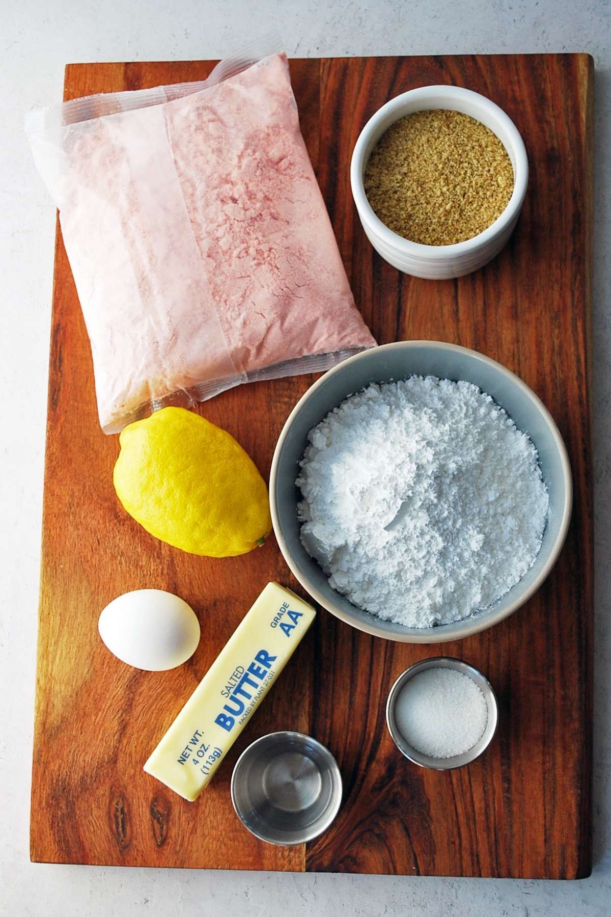 Ingredients for strawberry lemonade cookies on a cutting board