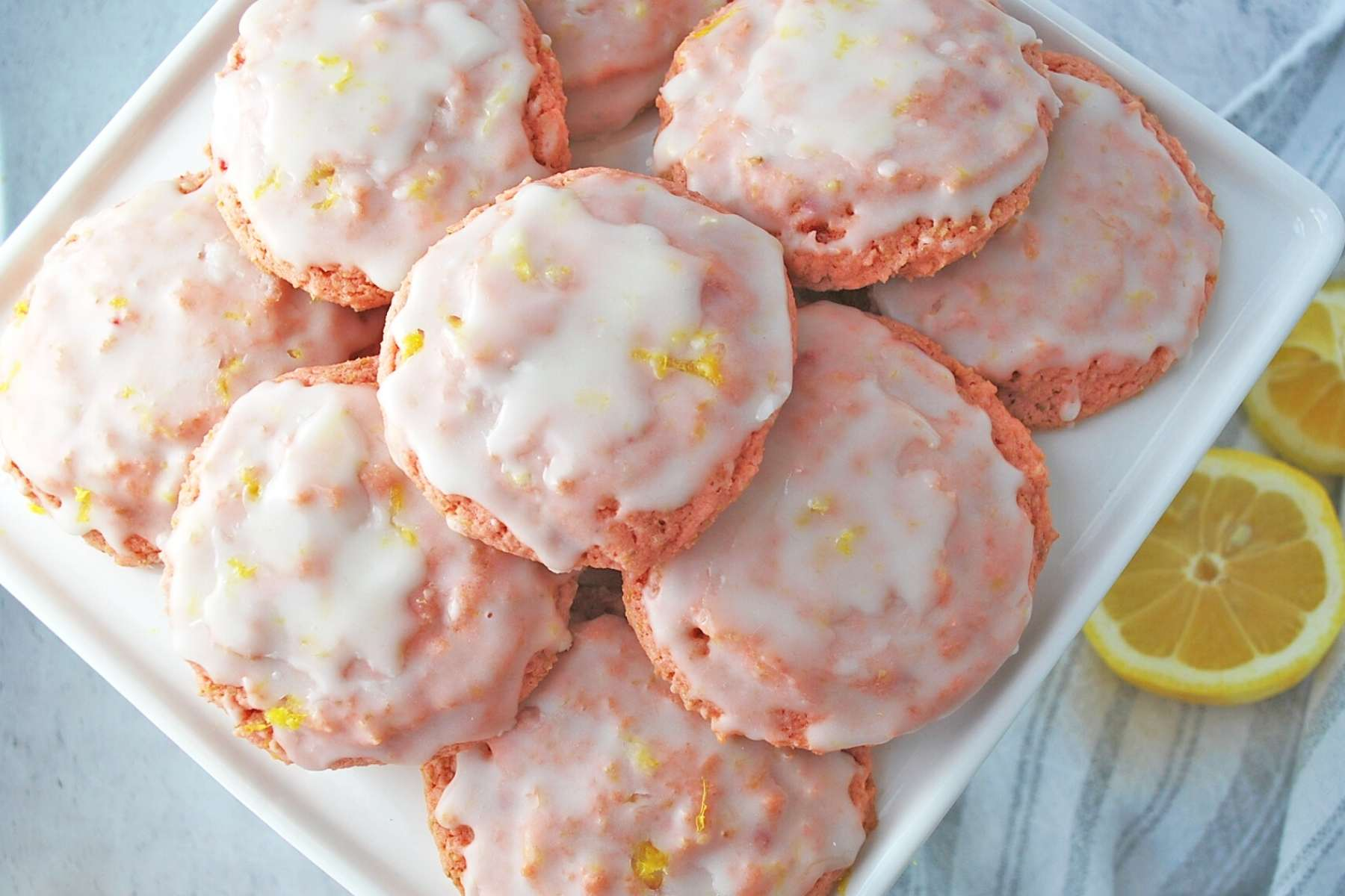 platter of strawberry glazed cookies with lemon
