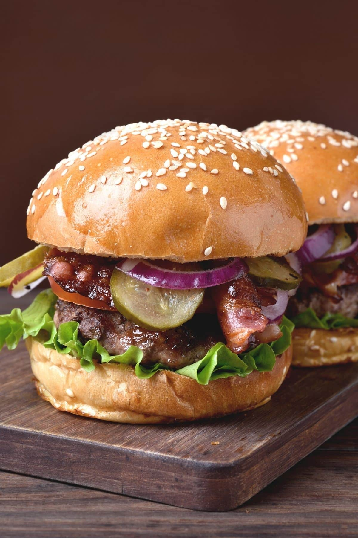 two loaded burgers on a platter