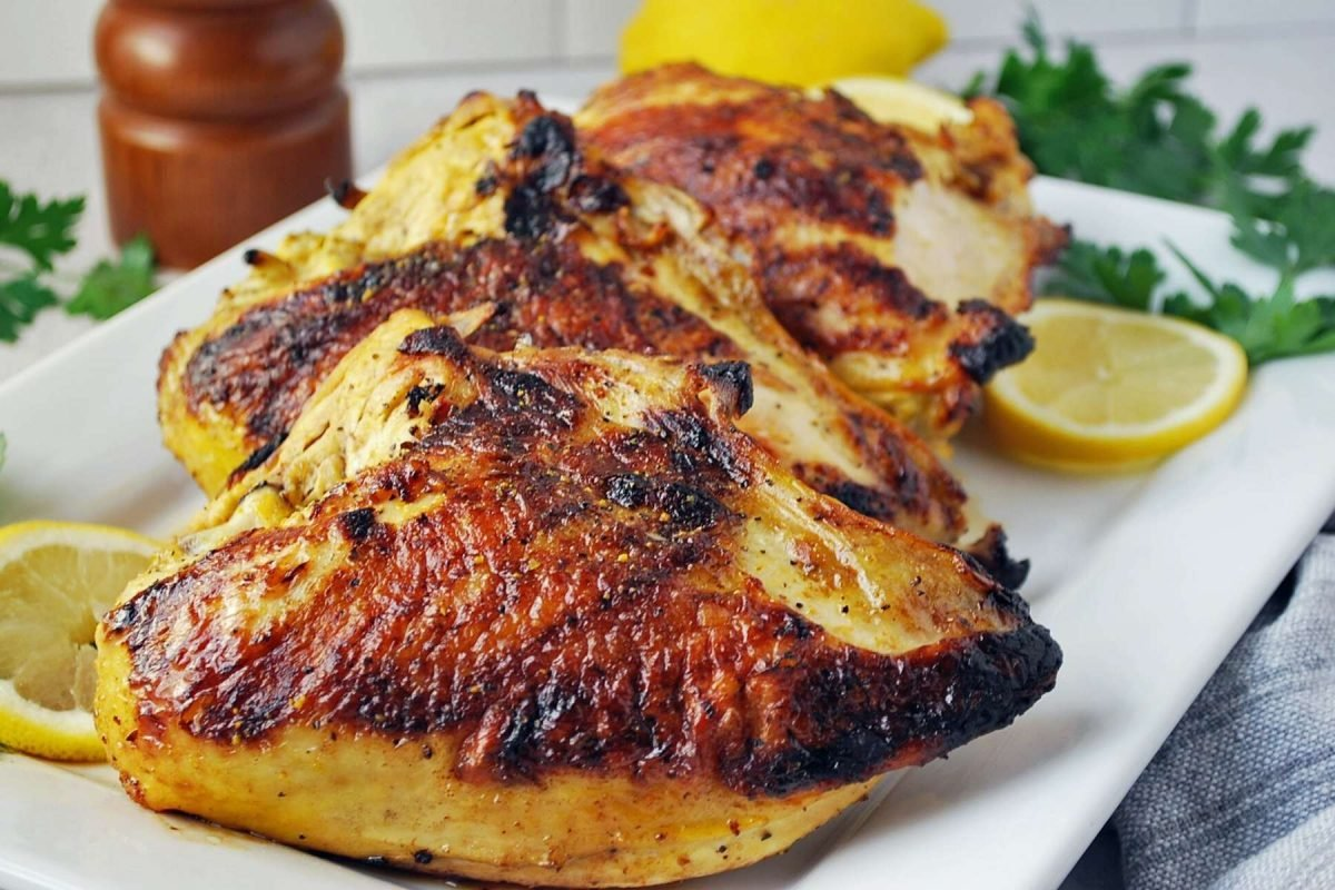Grilled lemon pepper chicken on a cutting board