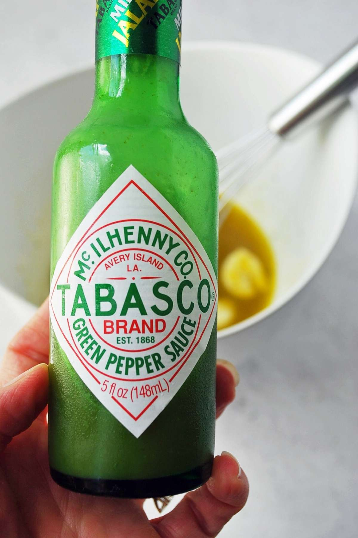 Close up photo of a jar of Green Tabasco