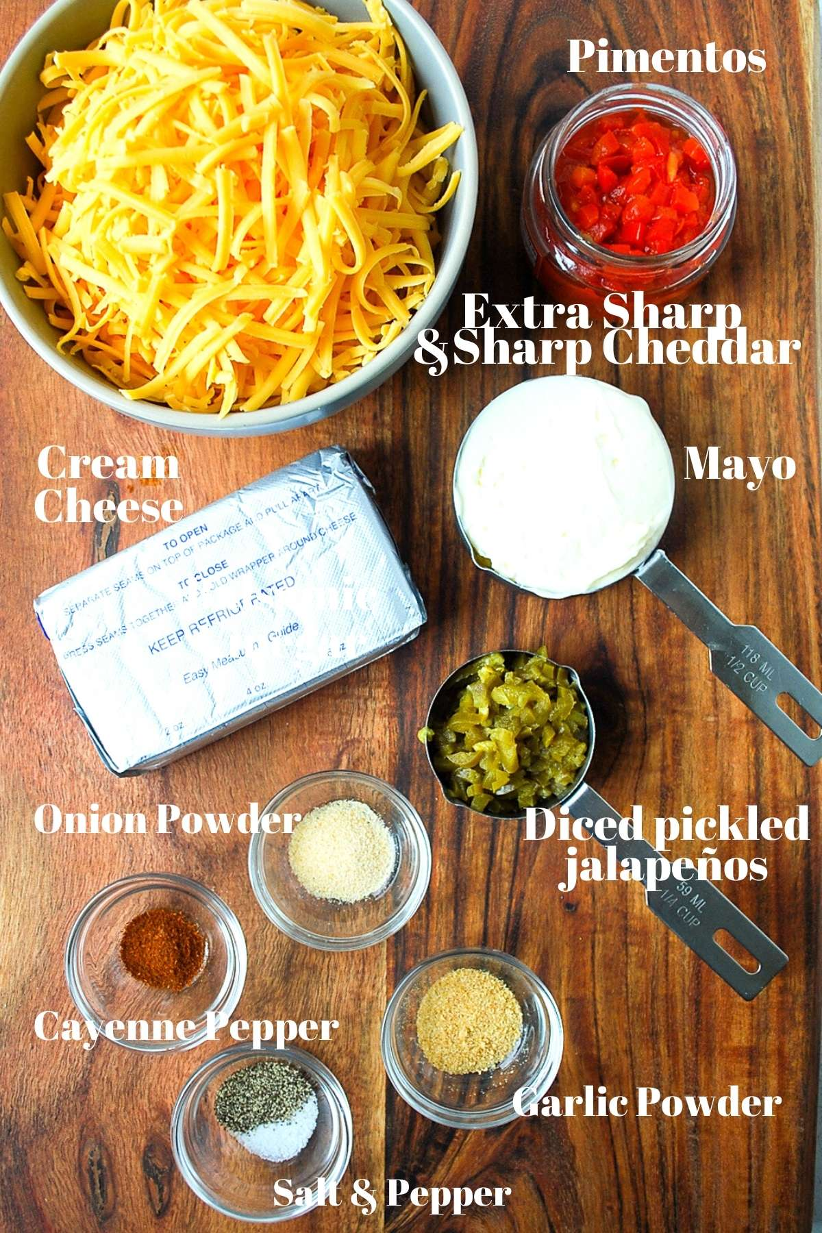 Shredded cheese, cream cheese, mayo, pimentos, jalapenos, and spices for making pimento cheese