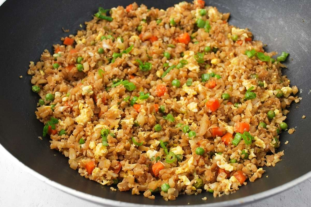 cauliflower fried rice cooked in a wok
